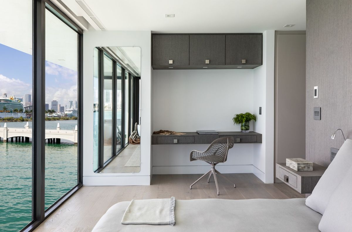 The bedrooms also have chic little work areas and beds that face the glass walls