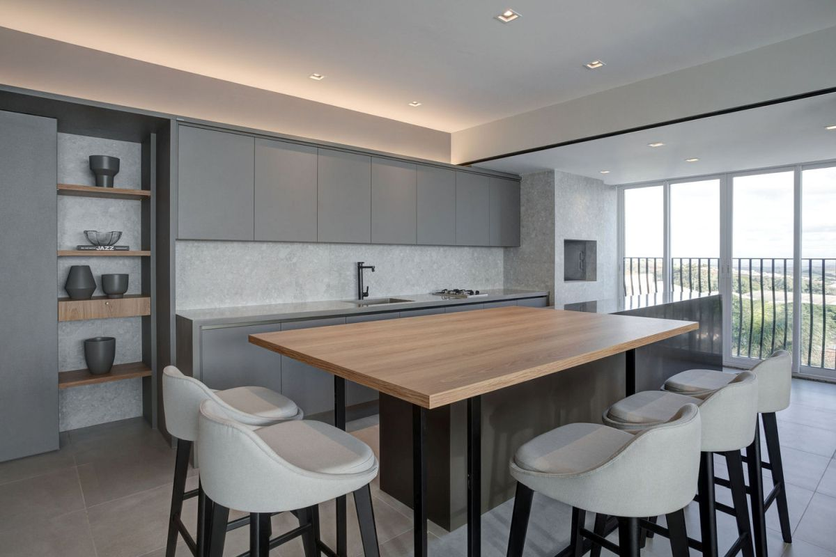 The kitchen island's table extension is multifunctional and really great for entertaining guests