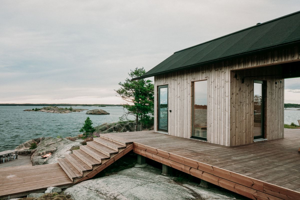 The cabin rises above the rocky terrain, featuring this floating deck that extends around it on all sides