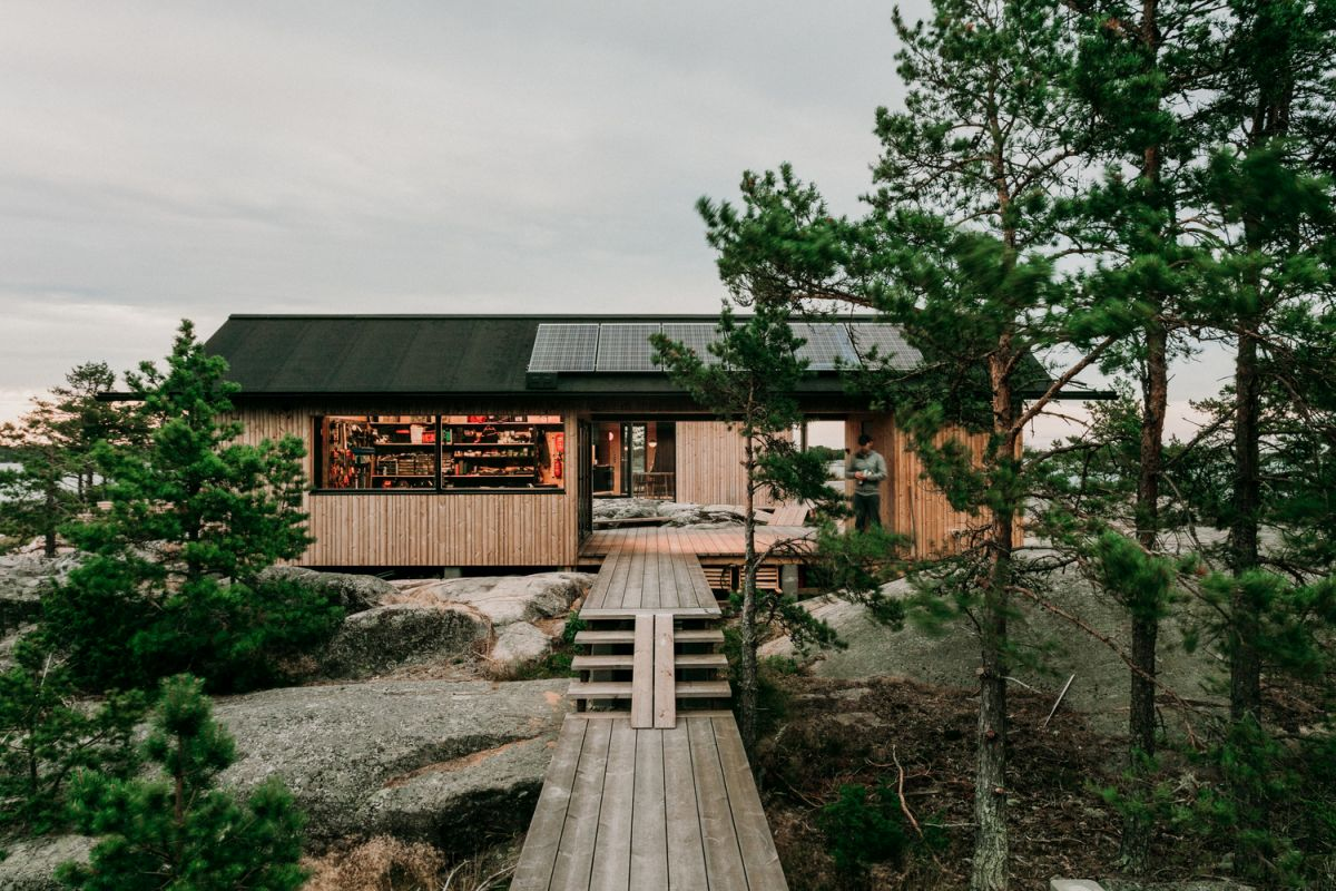 This summer cabin has its own little island filled with trees and beautiful vegetation
