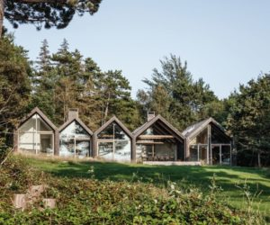 Five Connected Cabins In A Forest Clearing With A View Of The Sea