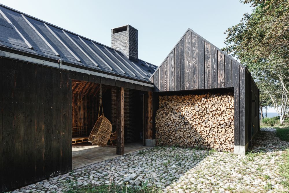 The fire-treated wood boards have a very unique look which helps the cabin blend into the landscape