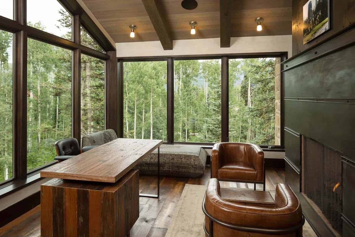 All the natural wood gives the house a strong rustic vibe which is always balanced out by the large windows, a sign of modern design