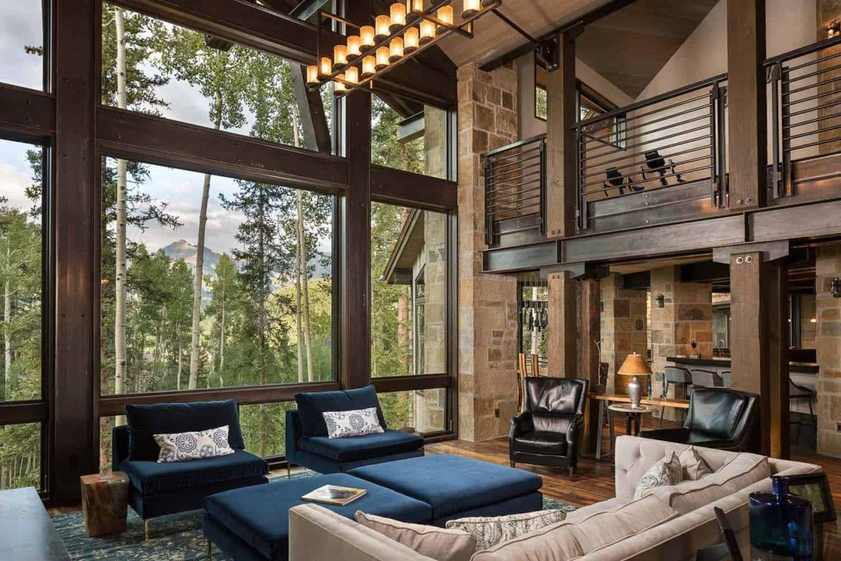 Large windows and glass walls connect the interior living areas to the outdoors and also help to create an airy decor