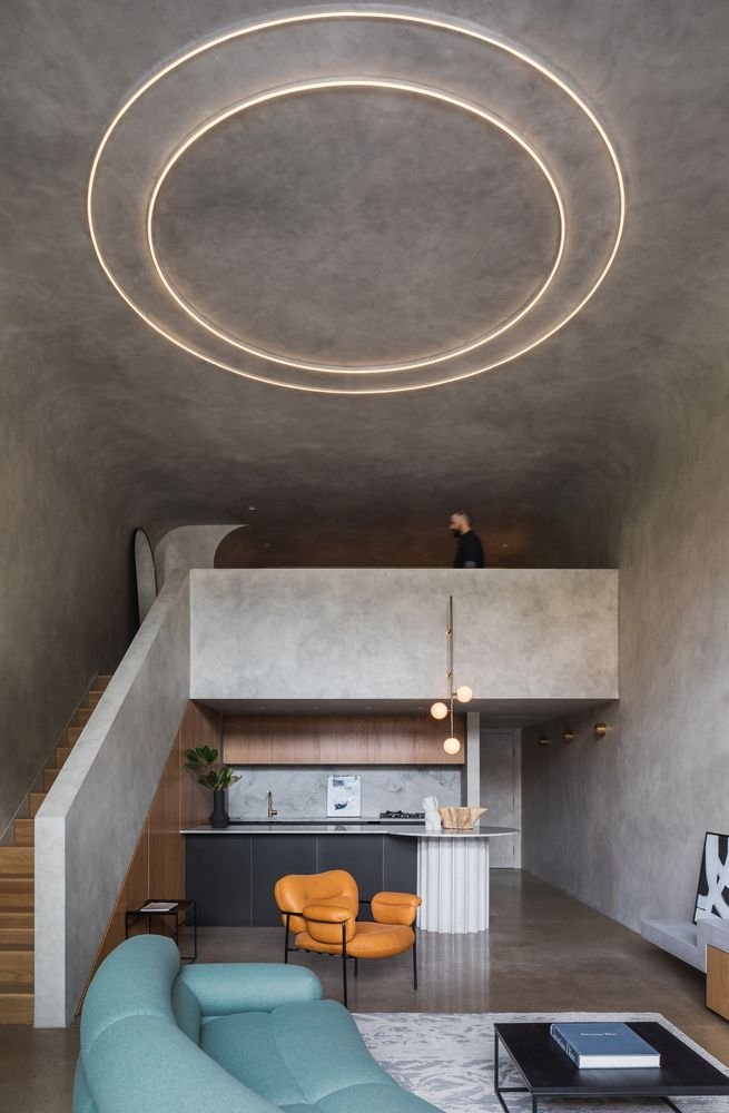 Modern Warehouse Loft Turned Into A Cozy Concrete Bunker