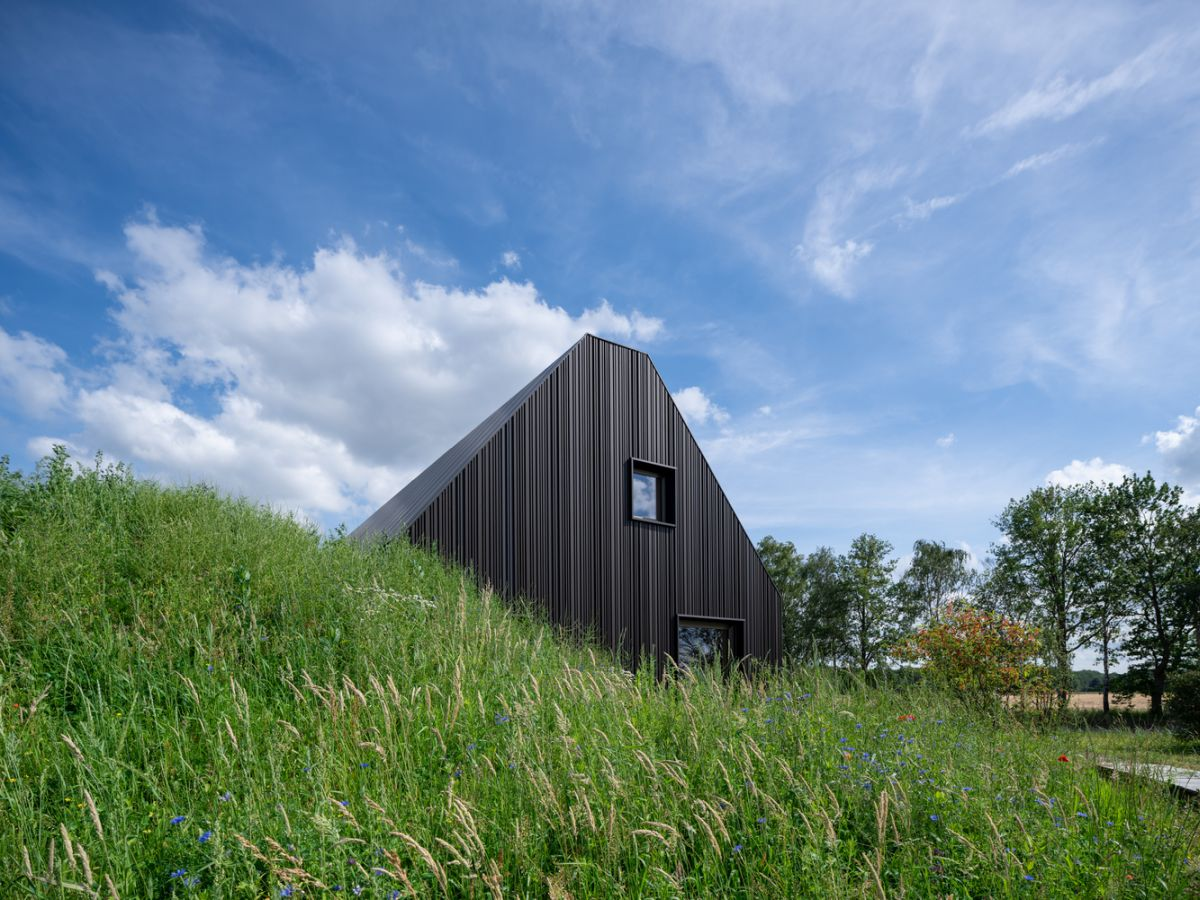 The two lower volumes are shaped like gabled barns but feature a contemporary design