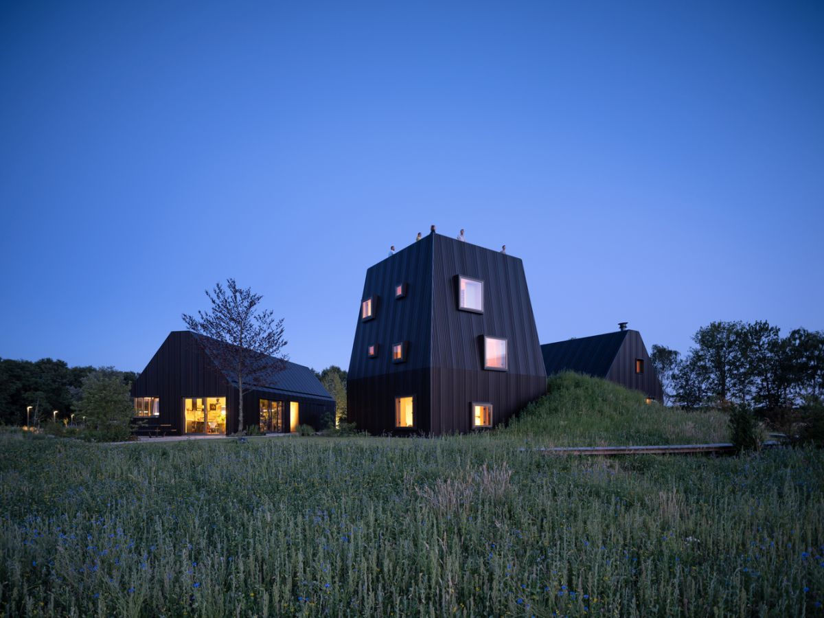 The windows on the higher volume are small and offset, giving it a playful appearance