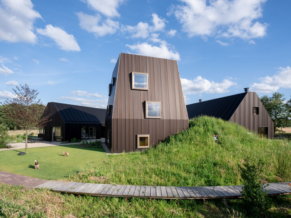 The dark bronze anodized aluminum cladding on the exterior of the structures is reminiscent of the corrugated roofs of the nearby farmhouses