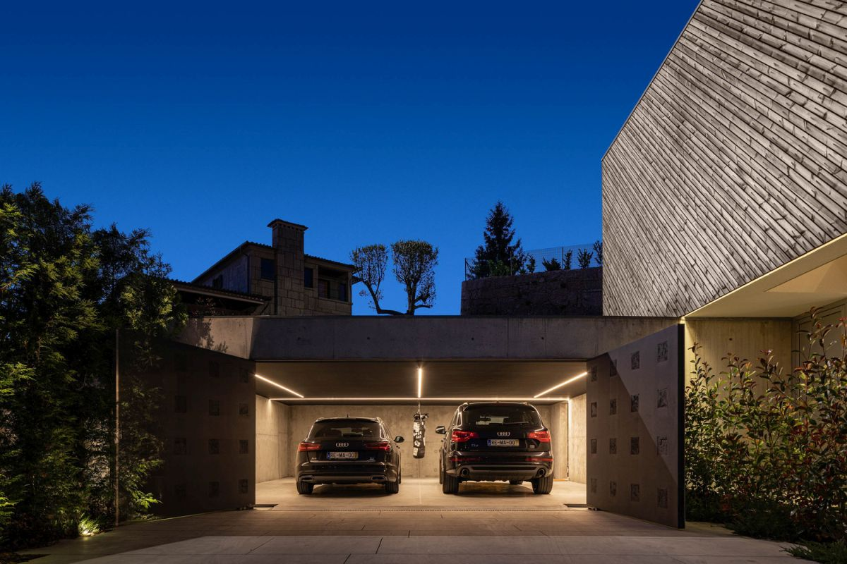 The garage is part of the lower level which is partially built into the hillside and underground