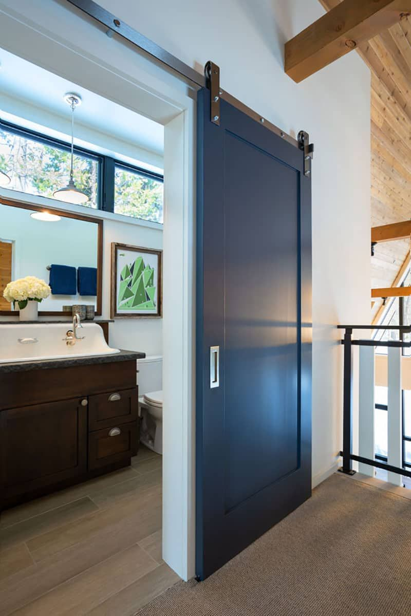 Modern barn doors were seamlessly incorporated into the design, as an homage to rustic cabins