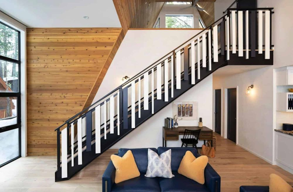 A classic black and white striped pattern was chosen for the staircase which connects the two floors