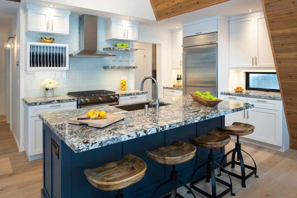 The kitchen island is multifunctional and has a built-in sink