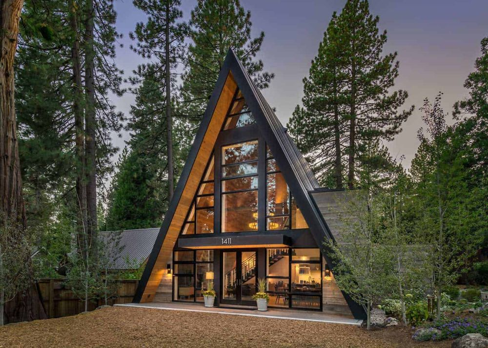 Staying true to the A-frame design guidelines, the cabin's roof extends all the way to the ground