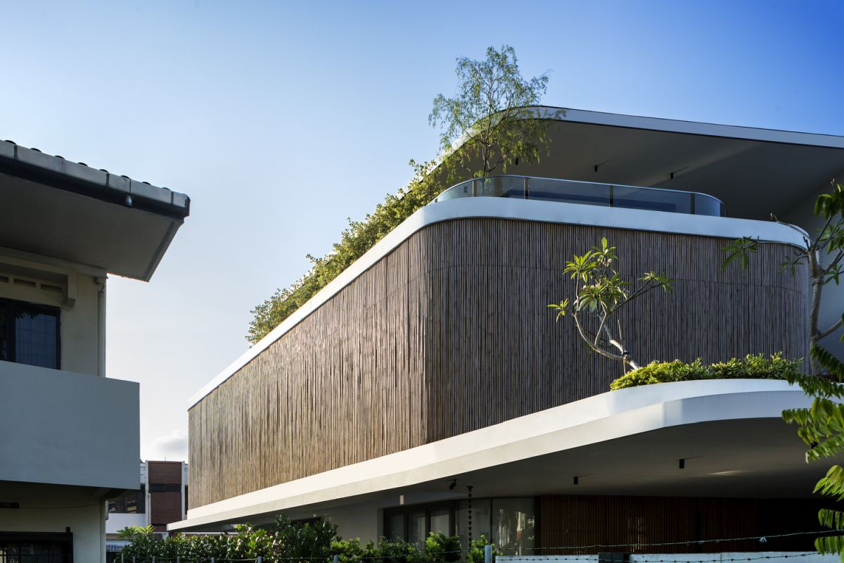 The bamboo veil forms the outer shell of the facade, being part of a two-layer design