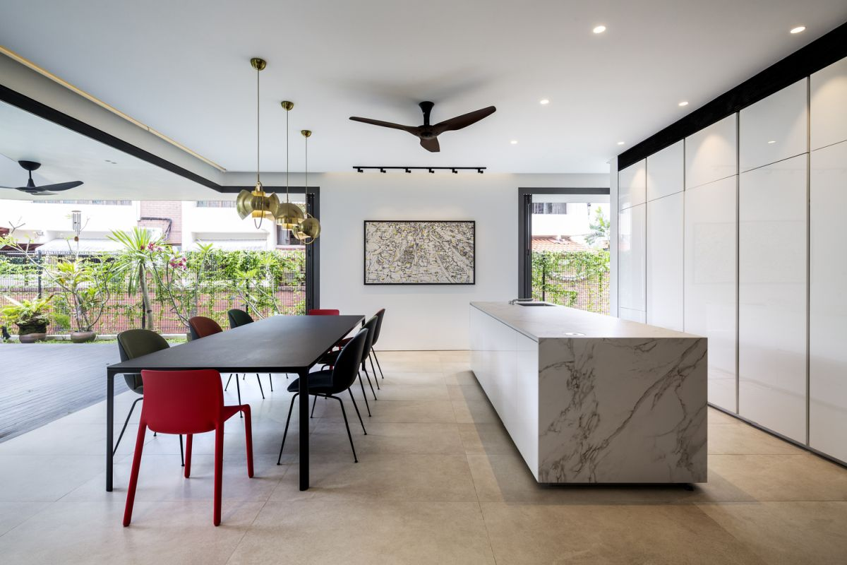 The open space kitchen and dining area transition into a terrace and a small garden