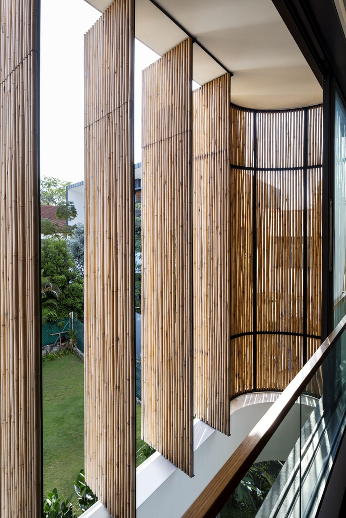 The facade has curved edges which are emphasized even more by the bamboo veil