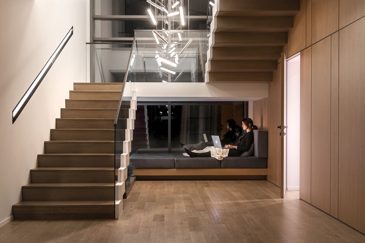 A cozy and inviting seating area was created underneath the stairs on the ground floor