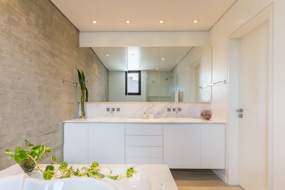 Large mirrors give the bathroom is bright and airy look