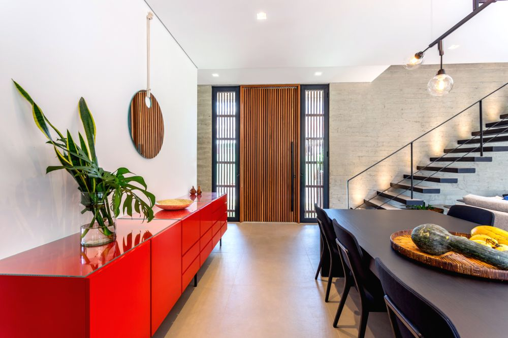 The vivid pops of color add an unexpected and exciting twist to the interior design of this contemporary house