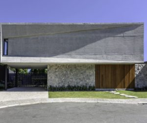 Concrete And Stone House With A Camouflaged Front Door