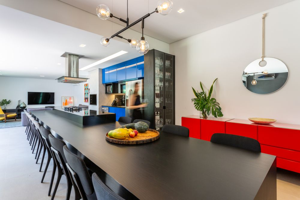 The kitchen island extends into a large dining table which is ideal for entertaining large groups