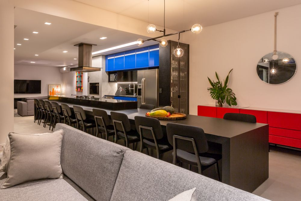 The minimalist, contemporary interior design is complemented by primary colors in bold nuances