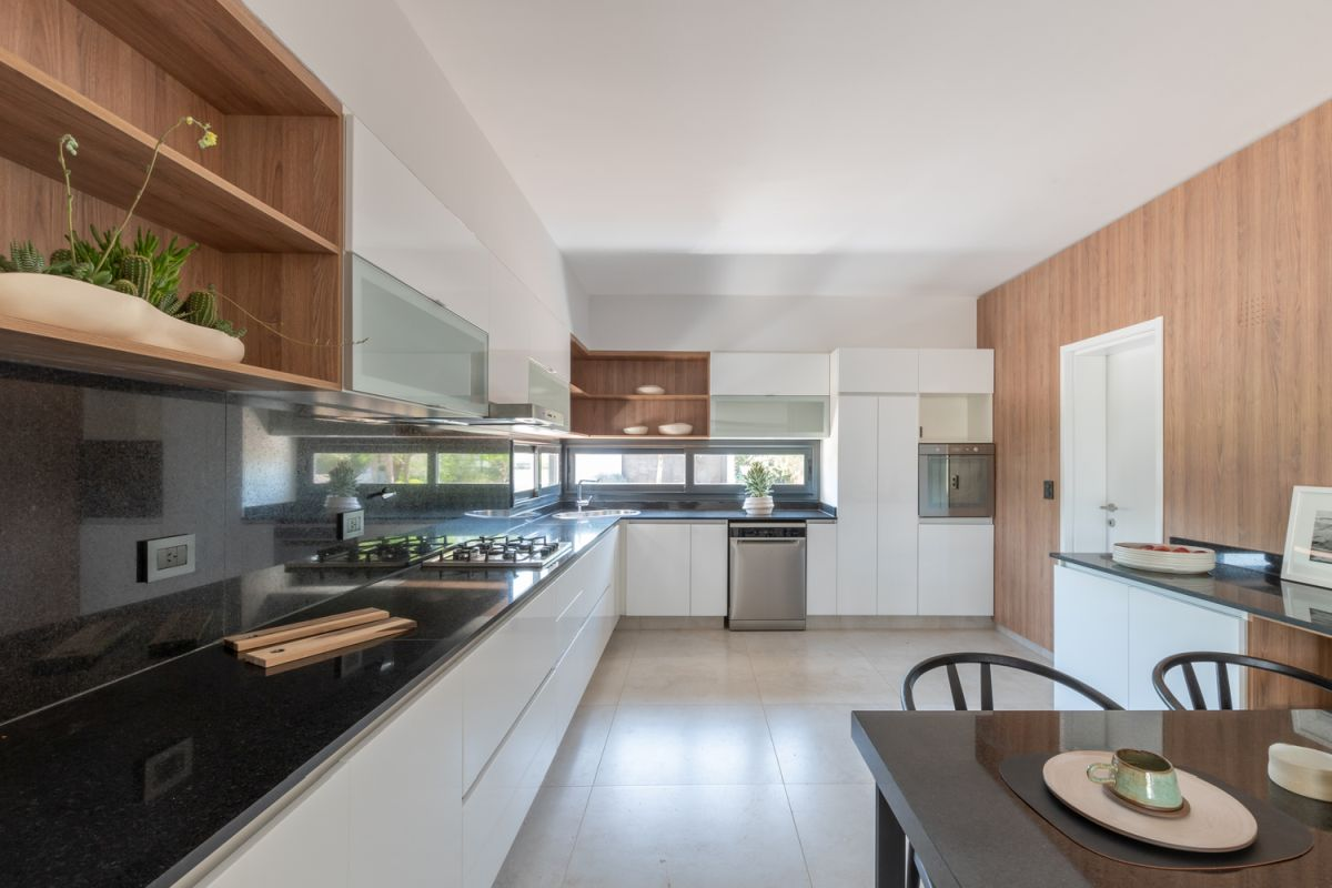 The kitchen stretches across two walls and extends into the dining area