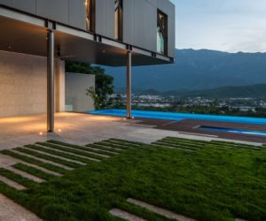 Cantilevered House Perched Dramatically On A Steep Slope