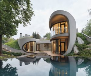 An Organic House Surrounded by Artificially-Created Landscape