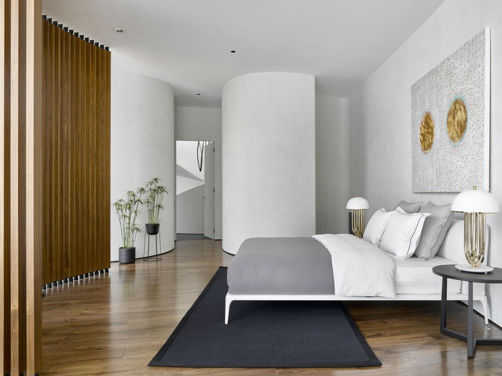 The wooden flooring complements the white walls and creates a sense of warmth and comfort