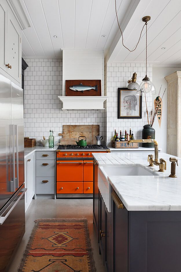 Kitchen with subway tiles and orange stove - Home Decorating Trends - Homedit