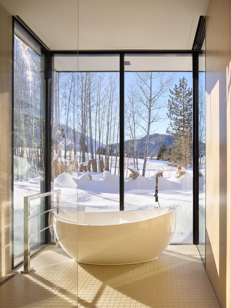 The freestanding tub was placed in a specially-designed glazed nook with gorgeous views