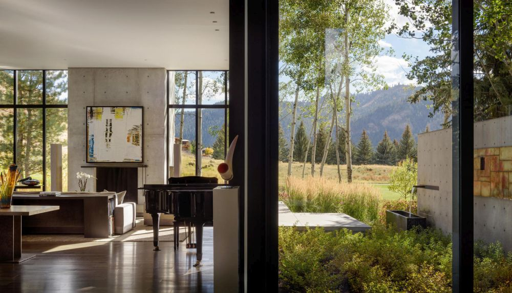 Large windows and glass doors bring in the beautiful colors of the surrounding landscape