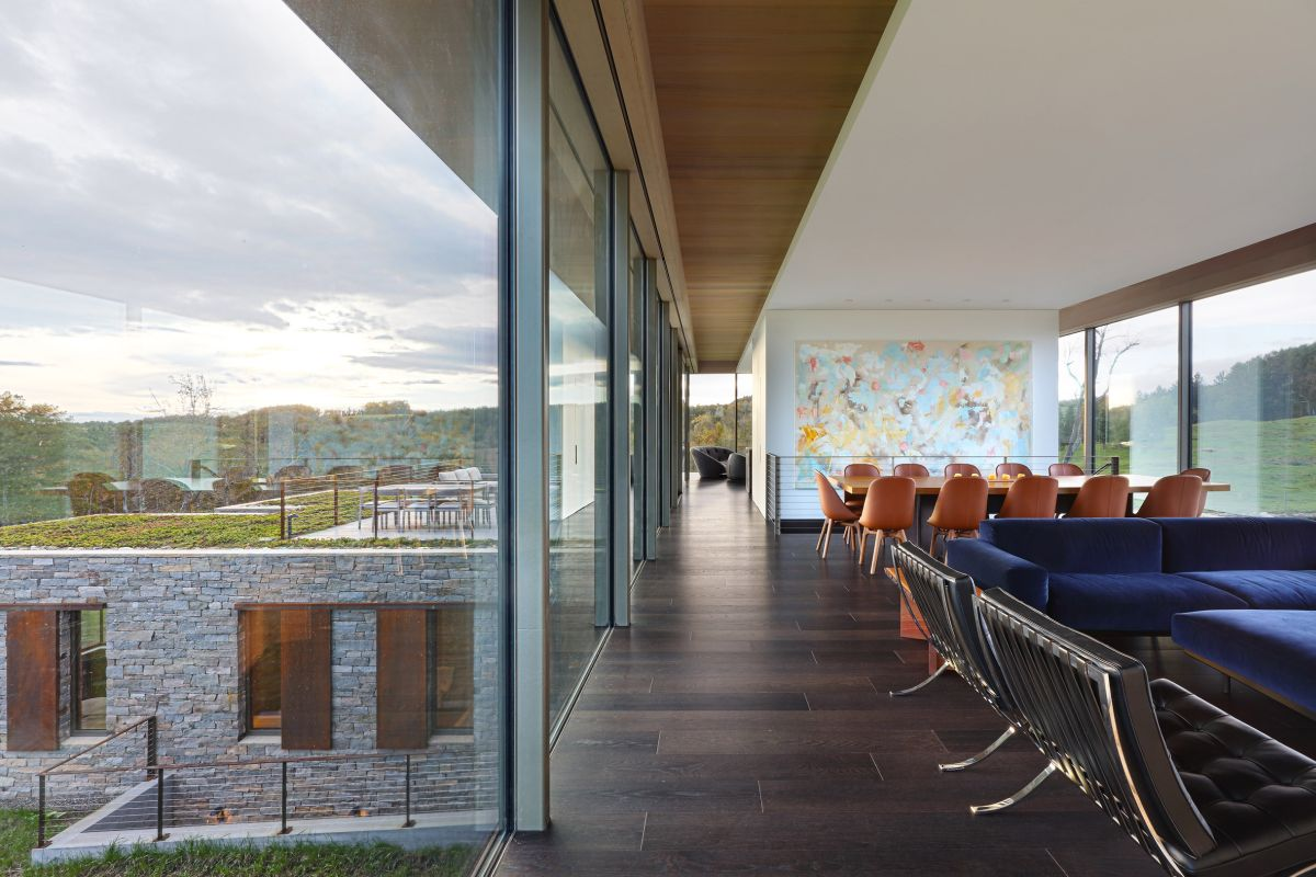 The rooftop terrace acts as an extension for the main living area situated on the upper level