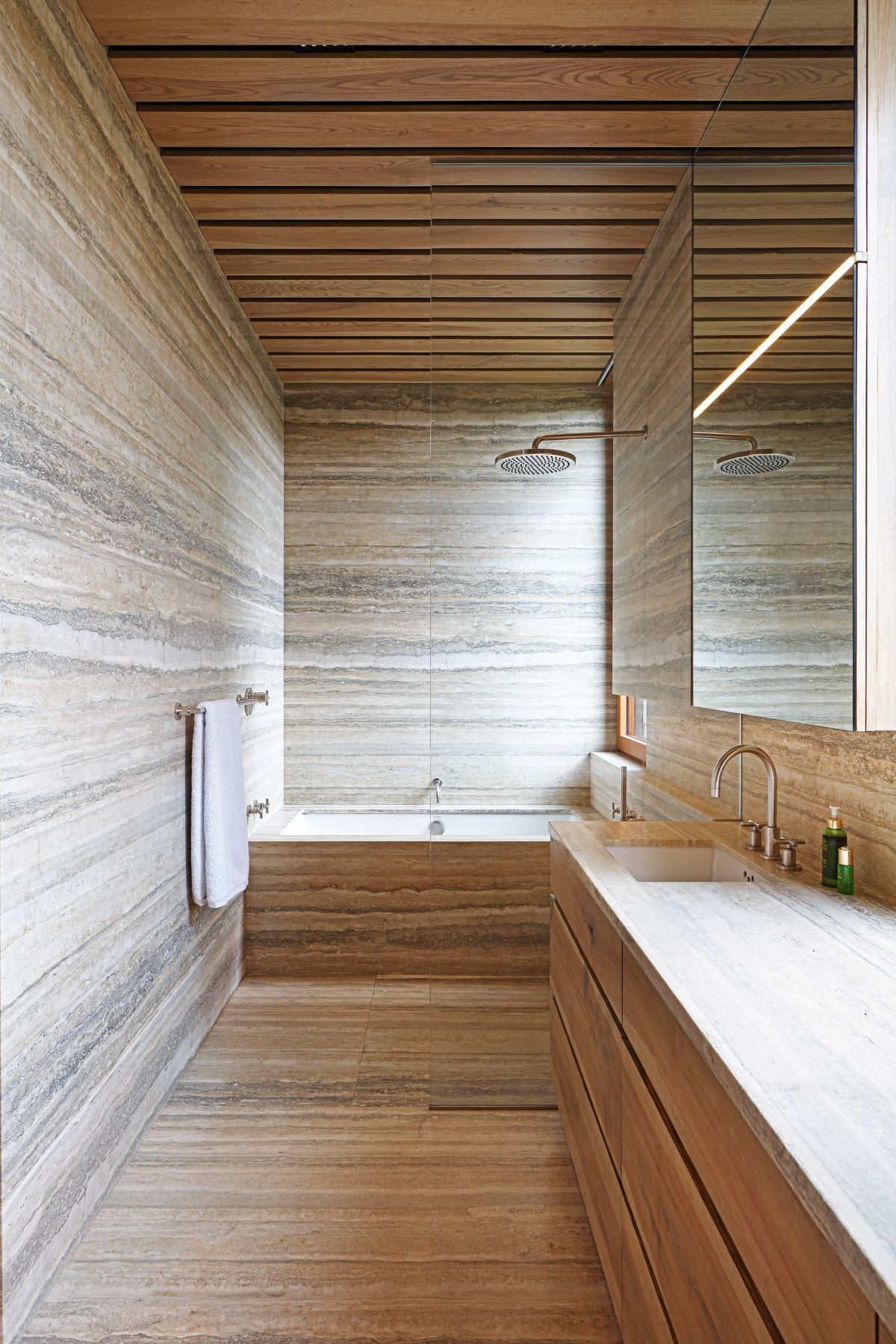 This bathroom has a very inviting and sauna-like feel due to all the wood