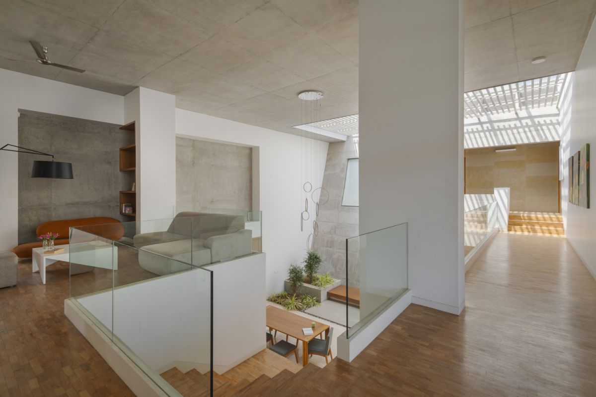 Internally the house is organized into multiple levels and volumes each with distinct functions