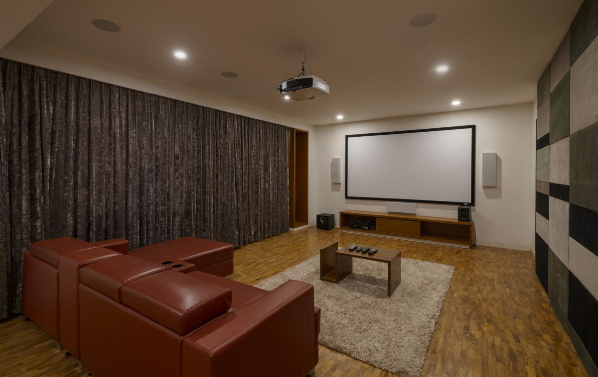The home theater is as elegant and stylish at the rest of the house, featuring wood cladding on the exterior