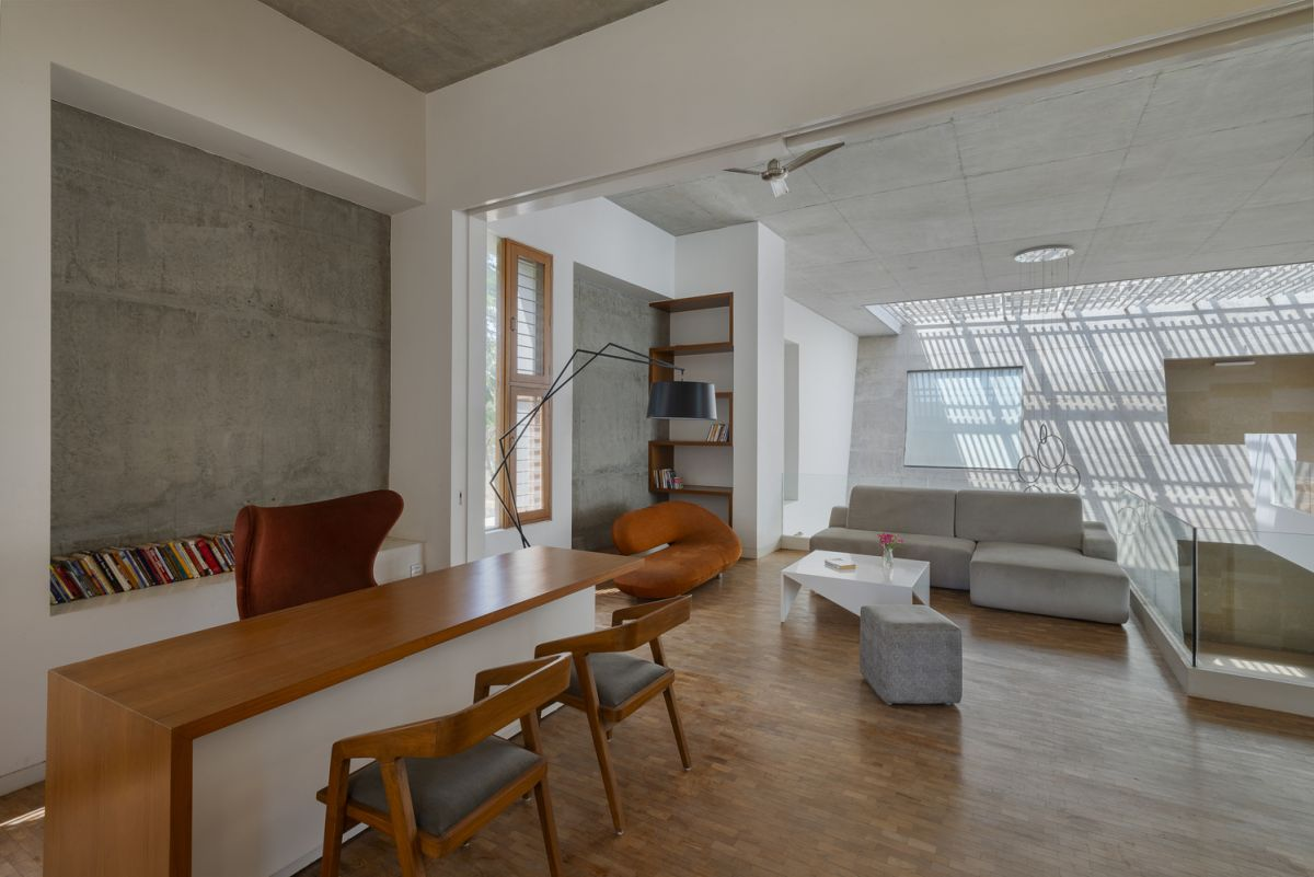 The house contains both social and office areas, including a cantilevered sections where business meetings take place