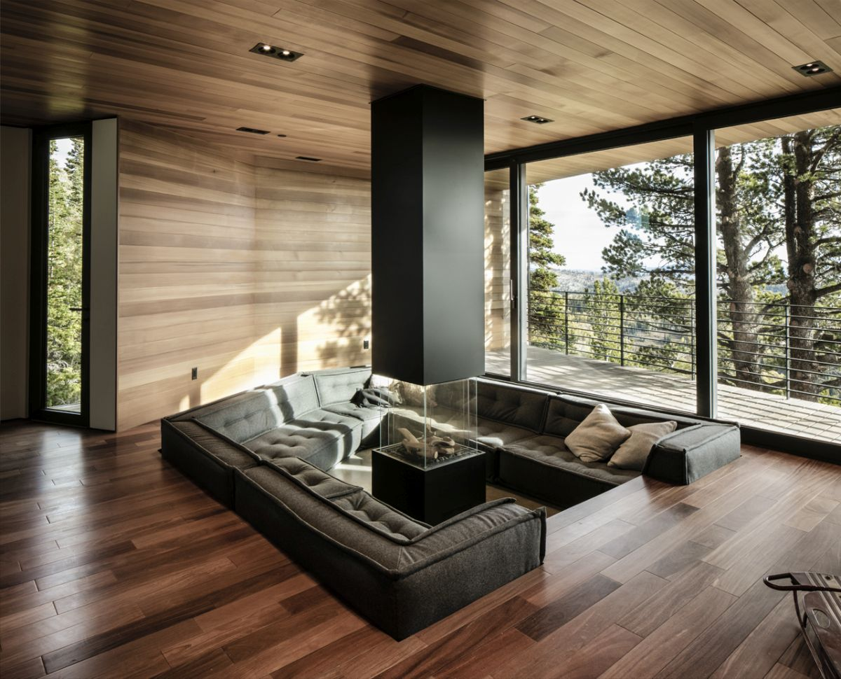 The sunken living room offers the advantage of added warmth and coziness but also of unobstructed views