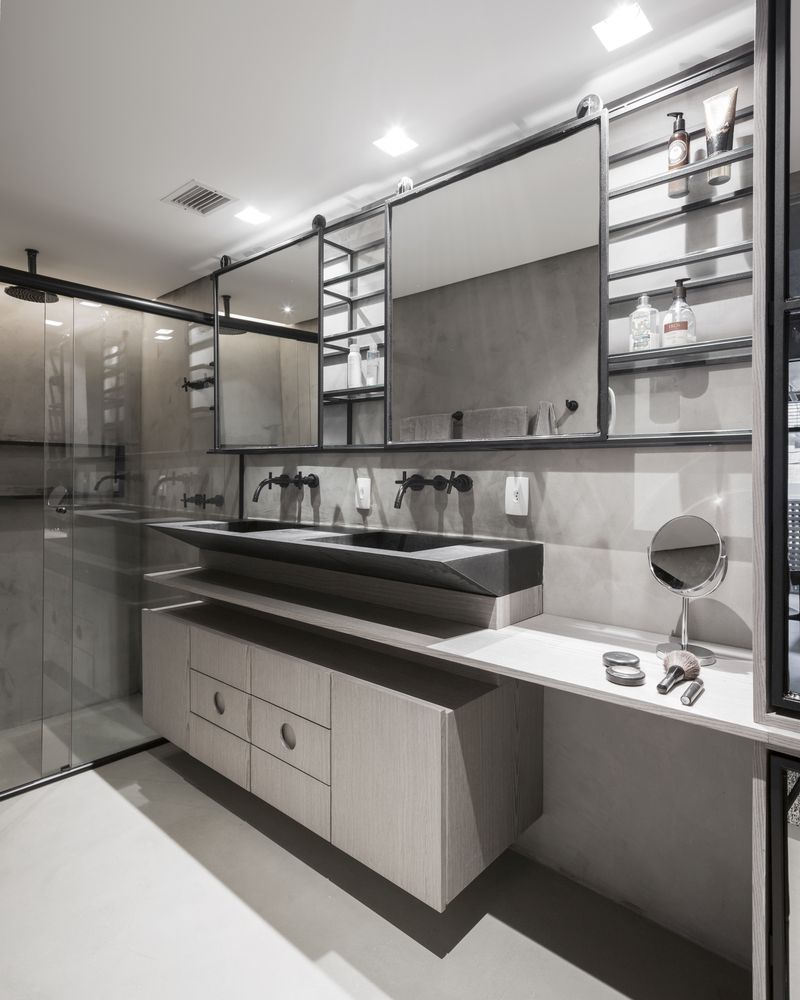 The bathroom is very neutral-colored as well, focusing mainly of light grays and white details