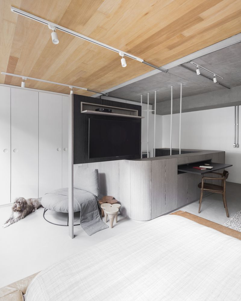Multifunctional spaces and furniture pieces are one of the defining characteristics of this apartment