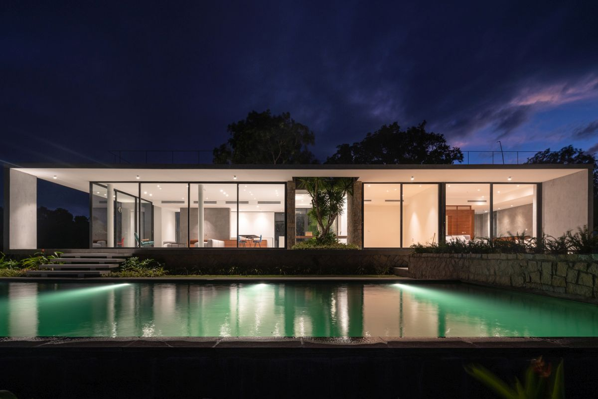This side of the house is fully exposed to the exterior through all the glass walls and doors