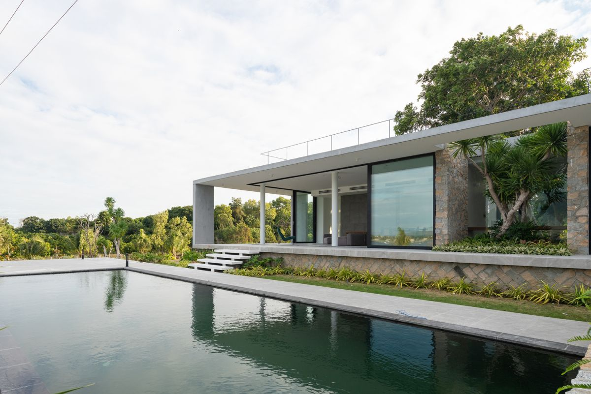 Tropical House in Vietnam Surrounded by Mango Trees And Shrimp Farms