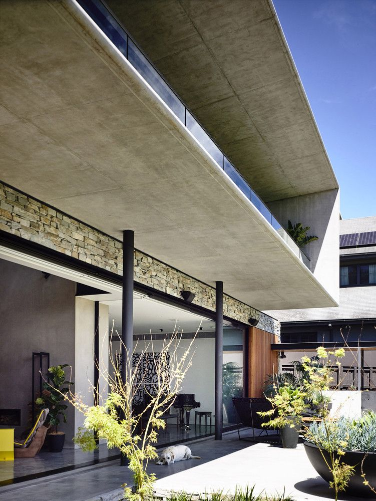 The exterior shell of the house is made of concrete which gives it a very simple and modern appearance