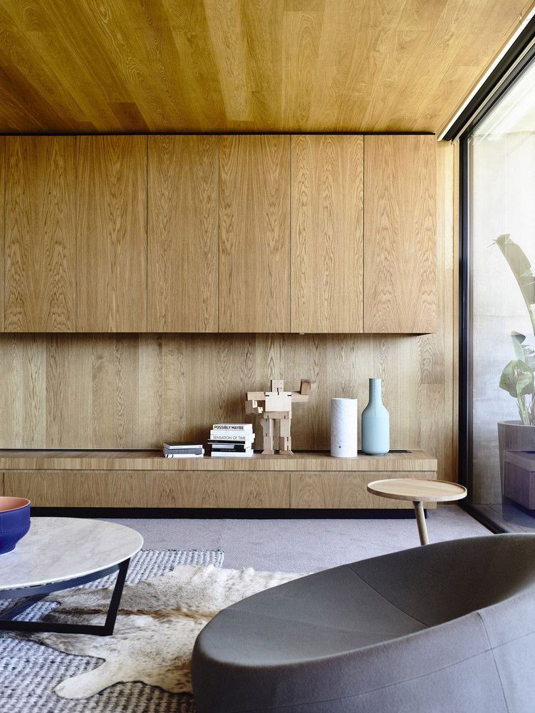 The extensive use of wood throughout the house complements the exposed concrete and adds lots of warmth to the decor