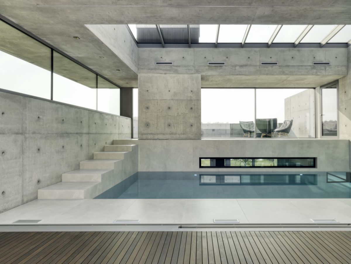 There's an indoor swimming pool on the second level of the house and has clerestory windows and a large skylight