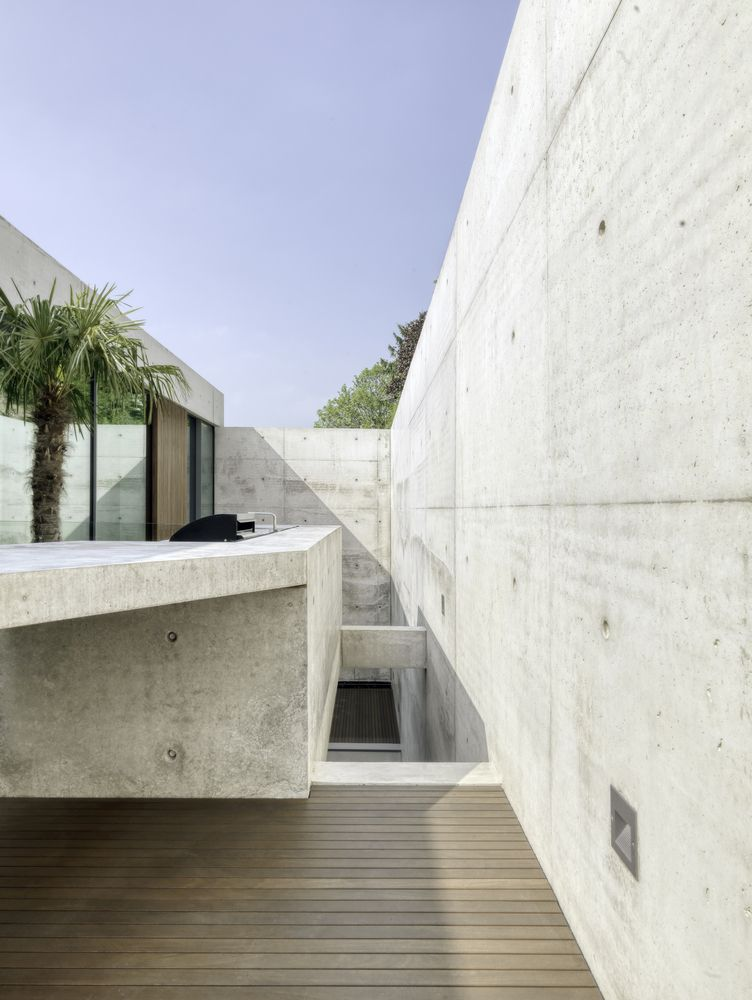 The extensive use of concrete all throughout this project gives the house a somewhat rugged appearance