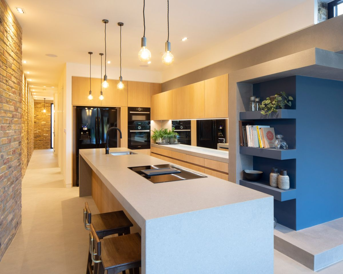 The open plan kitchen and the dining room are connected and they occupy the rear section of the house