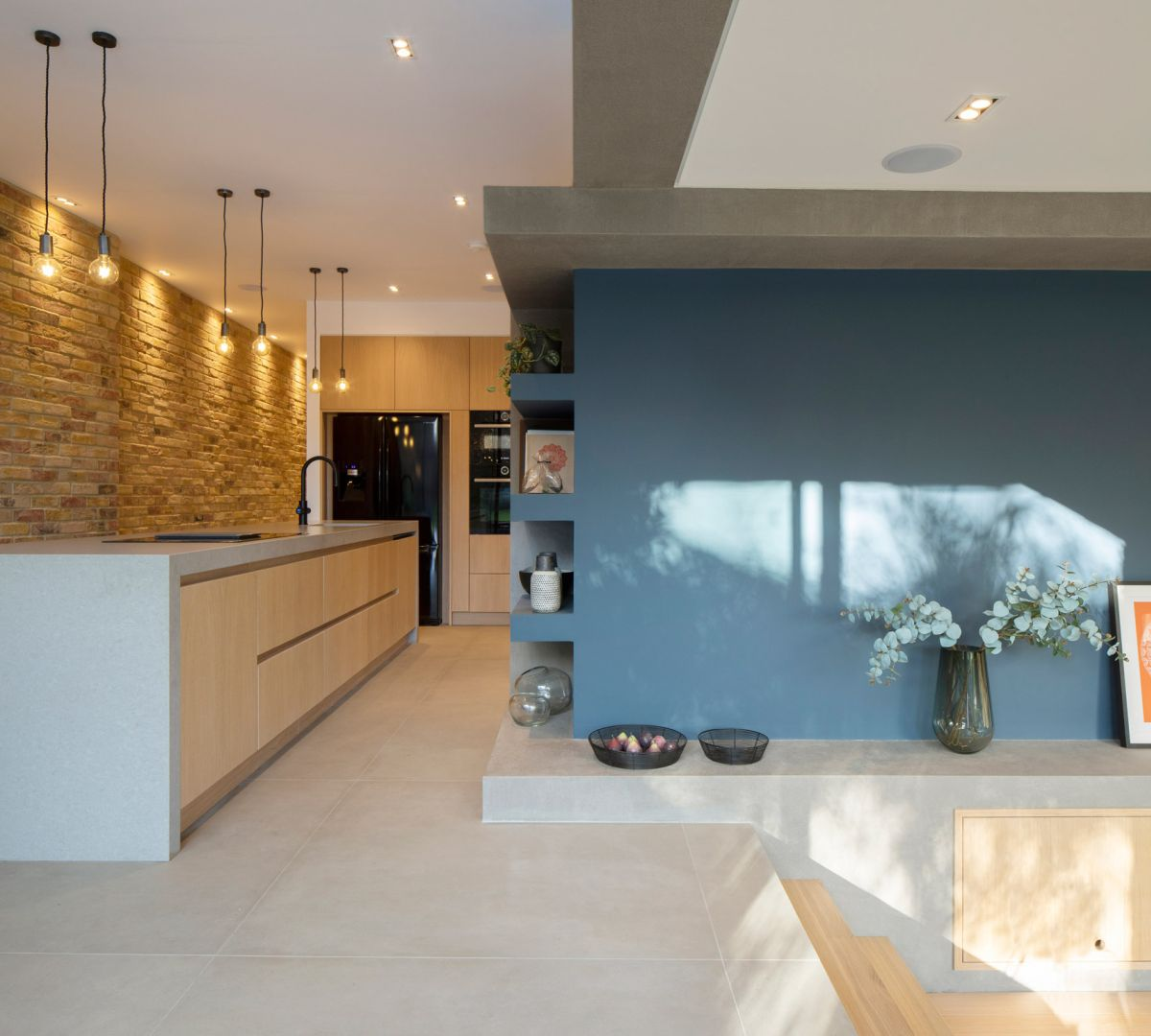 The architects found ways to distinguish the different zones within an open plan space through different floor levels