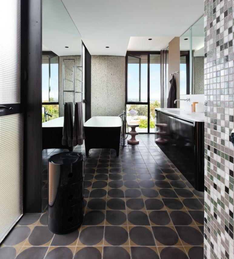 Large mirrors help to make the bathrooms look larger and more open by reflecting the spectacular views